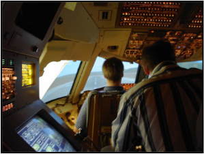 UGA Atmospheric Sciences students in a Delta Air Lines flight simulator.